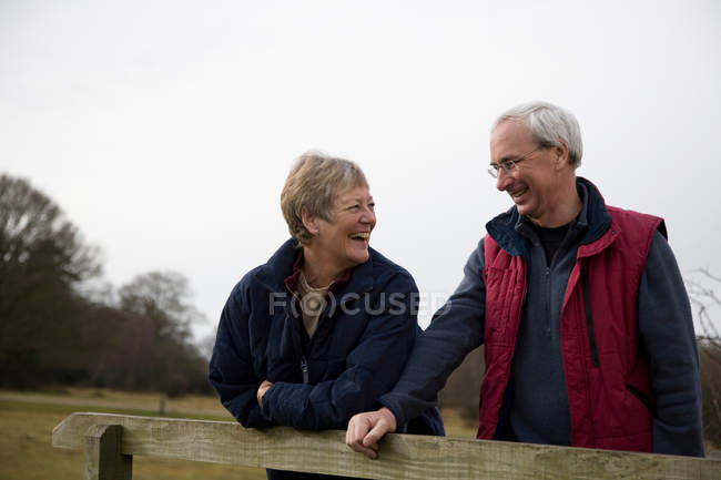 Retired Couple Laughing outdoors — Stock Photo