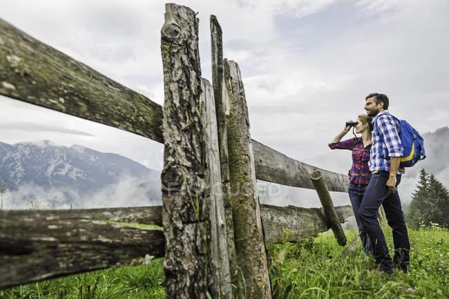 Couple enjoying view through binoculars, Tirol, Austria — Stock Photo