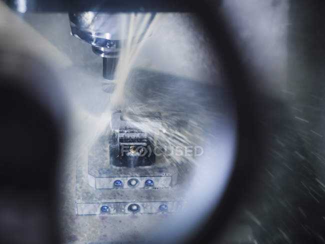Computer numerical controlled lathe in factory, close up — Stock Photo