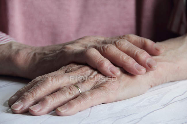Close up shot of older woman hands — Stock Photo