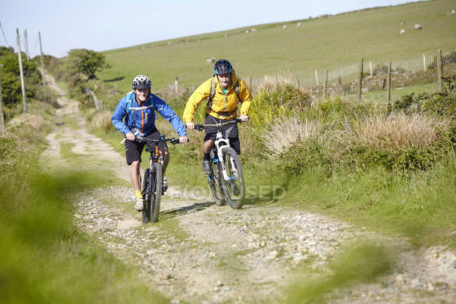 Cyclists cycling on dirt track — Stock Photo
