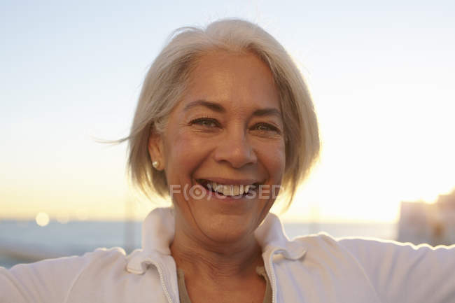 Close up portrait of silver-haired mature woman — Stock Photo