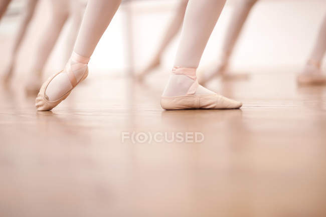 Detail of ballerinas legs in dance class, low section — Stock Photo