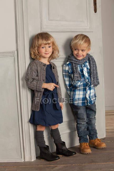 Children smiling together indoors — Stock Photo