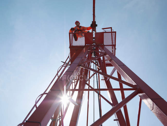 Crane Worker Looking Down From Crane — Stock Photo