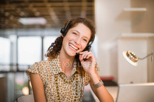 Smiling woman wearing headset — Stock Photo