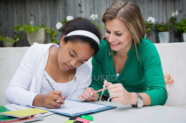 Student working with teacher outdoors — Stock Photo