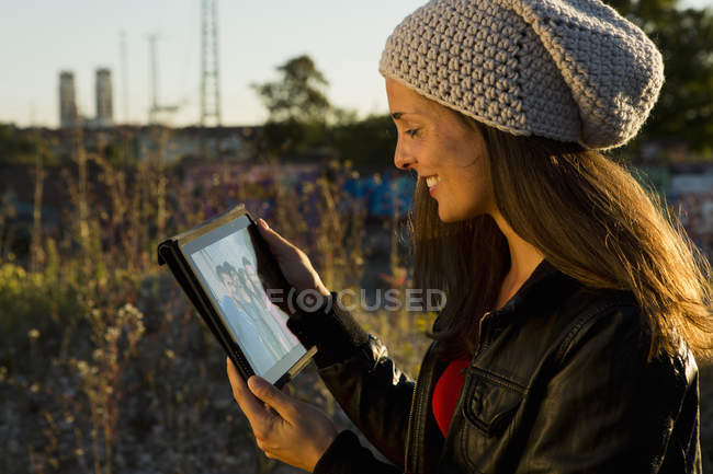 Young woman looking at digital tablet screen — Stock Photo