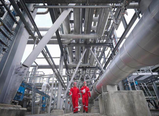 Workers in underground gas storage plant — Stock Photo