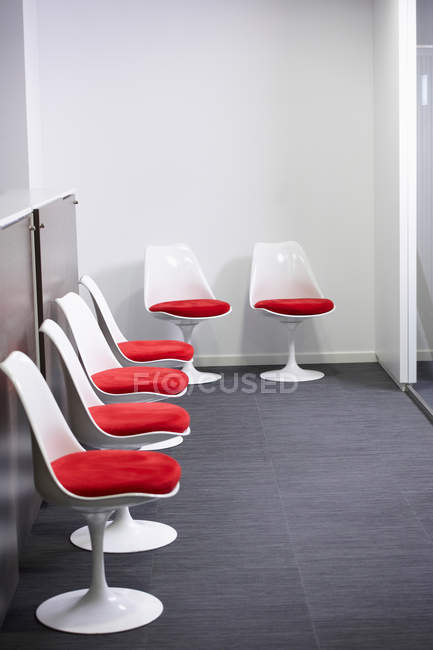 Six empty chairs at waiting room — Stock Photo