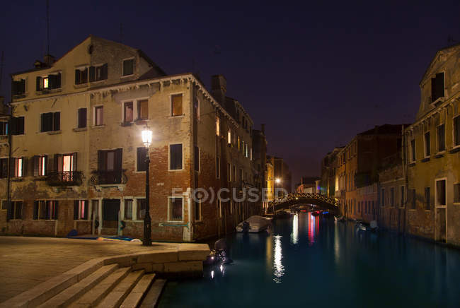 City lights reflected in urban canal — Stock Photo