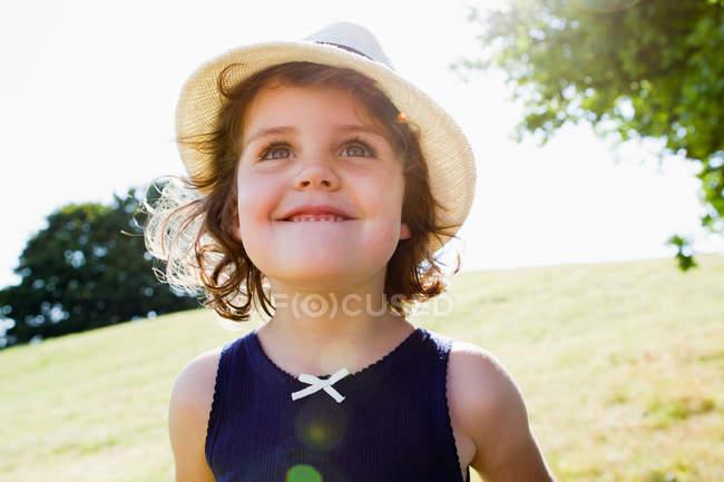 Smiling girl walking outdoors — Stock Photo