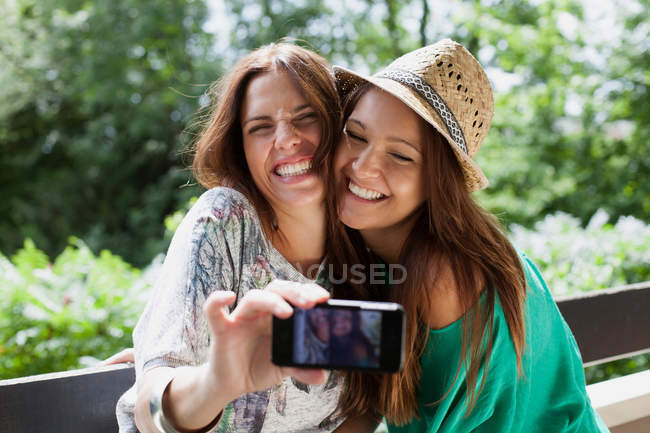 Women taking picture of themselves — Stock Photo