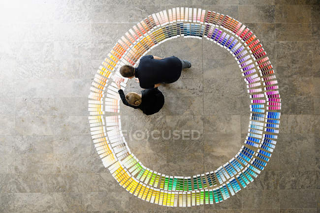 Business people examining paint swatches — Stock Photo