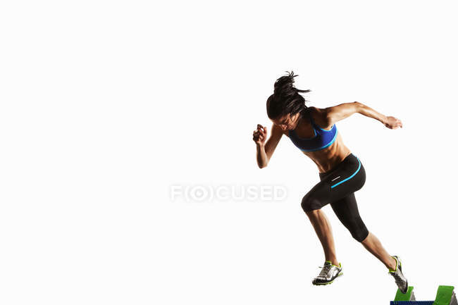 Athlete taking off from starting block — Stock Photo