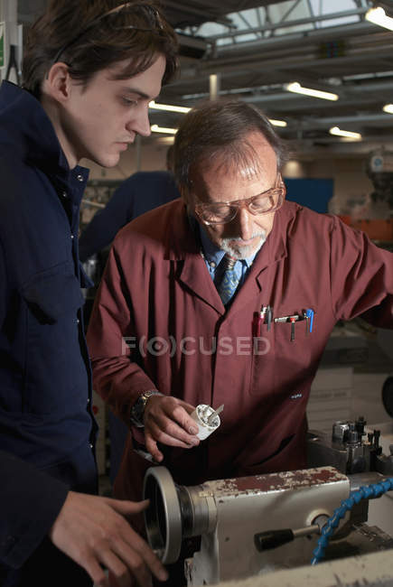 Teacher helping student in shop class, selective focus — Stock Photo