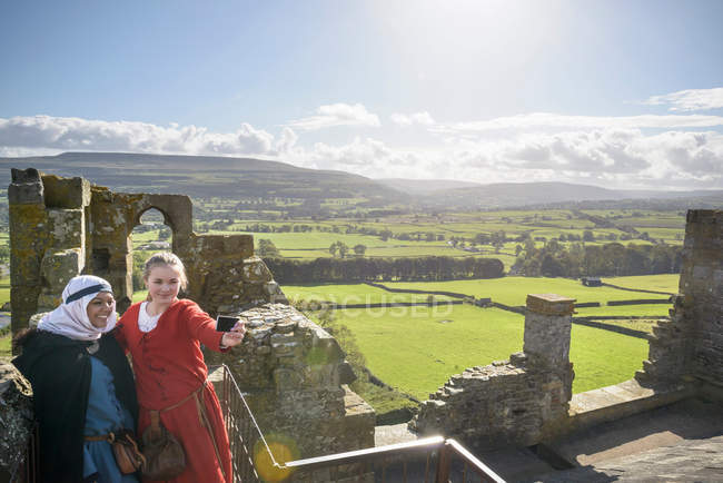 History students in period dress and camera on battlements of Bolton Castle with views of Wensleydale, high angle. A 14th century Grade 1 listed building, Scheduled Ancient Monument — Stock Photo