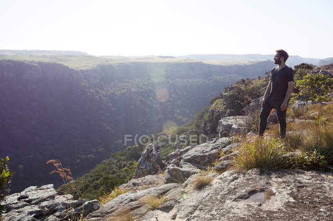 Man standing on mountain top, looking at view, South Africa — Stock Photo