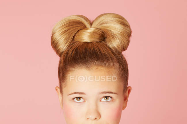 Teenage girl with ornate hairdo — Stock Photo