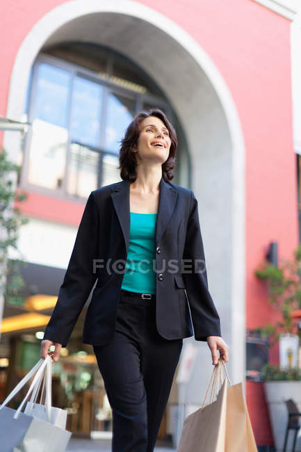 Businesswoman carrying shopping bags — Stock Photo