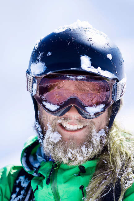 Close up of skier with snow-covered face — Stock Photo