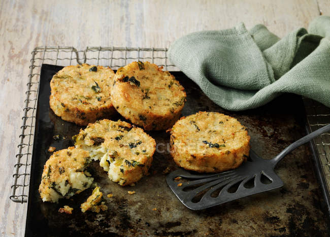 Bubble and squeak cakes on baking sheet — Stock Photo