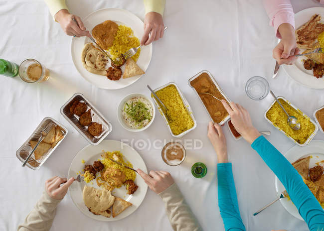 Overhead view of people at table — Stock Photo