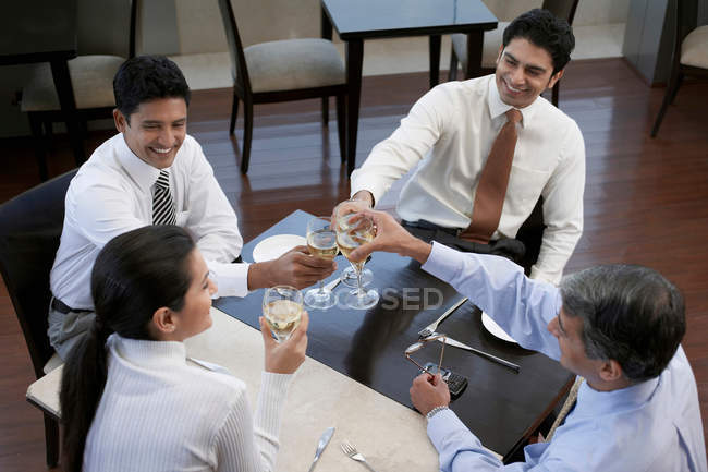 Business people toasting each other — Stock Photo