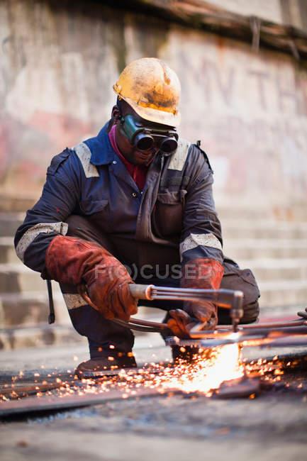 Welder at work on dry dock, selective focus — Stock Photo
