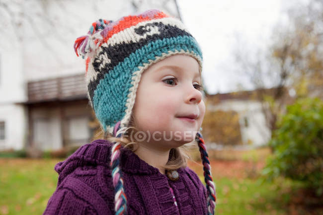 Portrait of girl in knitted cap outdoors — Stock Photo