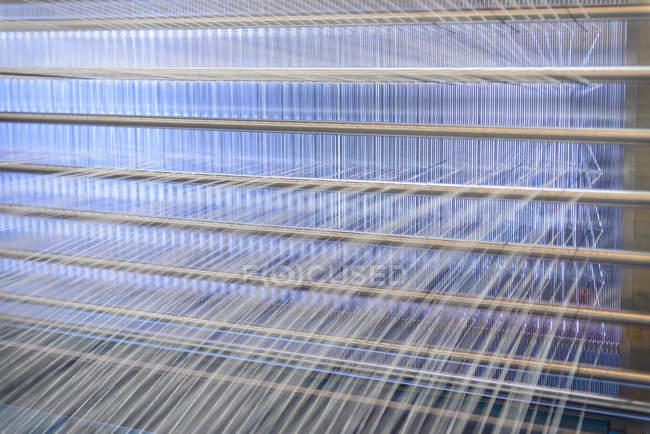 Threads on industrial loom — Stock Photo