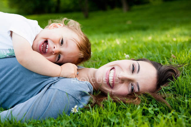 Mother holding toddler in park — Stock Photo
