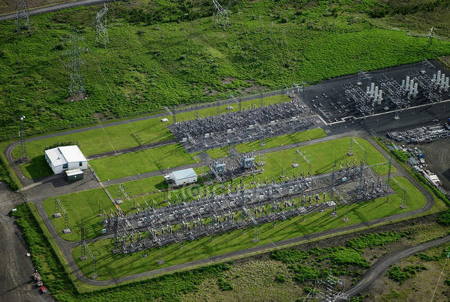 Aerial view of power grid in lush greenery — Stock Photo