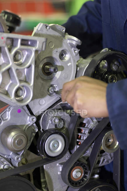 Close up of student working on engine, cropped shot — Stock Photo