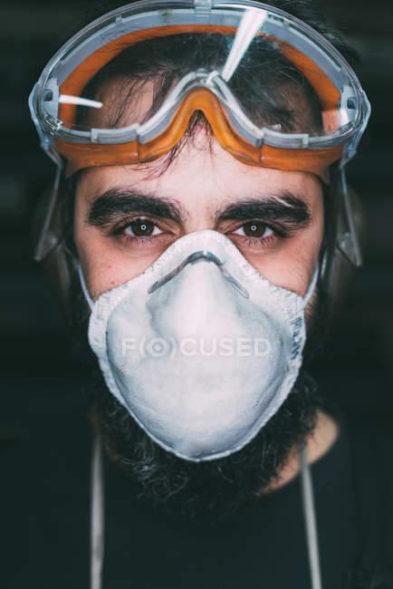 Portrait of male metalworker in dust mask — Stock Photo