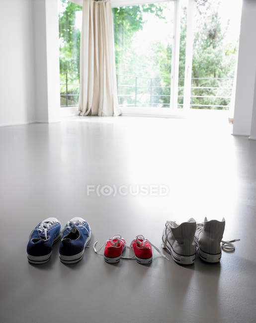 Close up shot of sportive shoes in row — Stock Photo