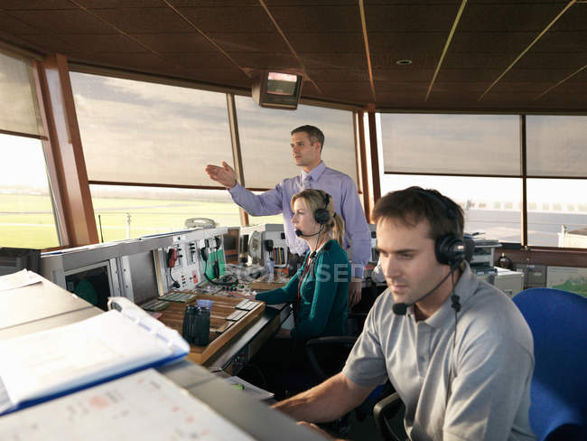 Air traffic controllers in tower — Stock Photo