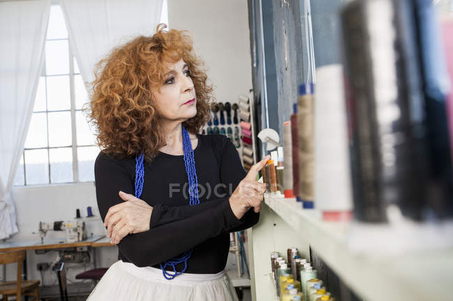Woman in sewing workshop looking away — Stock Photo