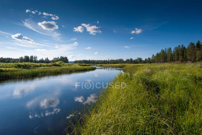 Sky and clouds reflecting in water — Stock Photo