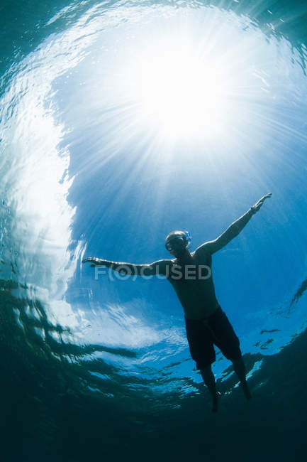 Snorkeler swimming in tropical water — Stock Photo