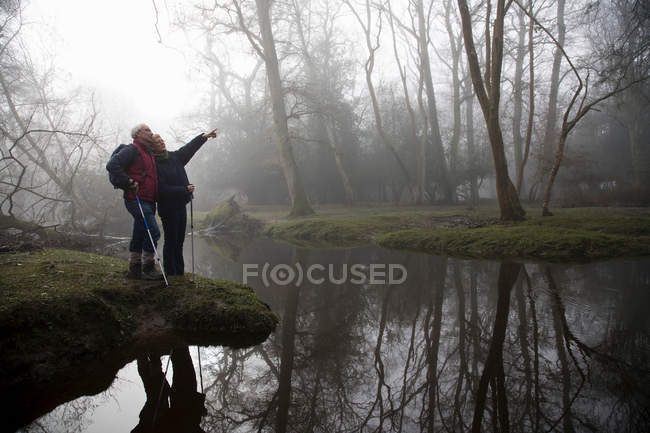 Retired Couple by River outdoors — Stock Photo