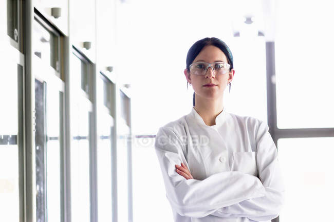 Portrait of female scientist wearing protective goggles — Stock Photo