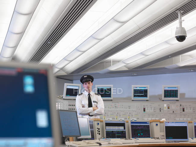 Security guard in control room — Stock Photo