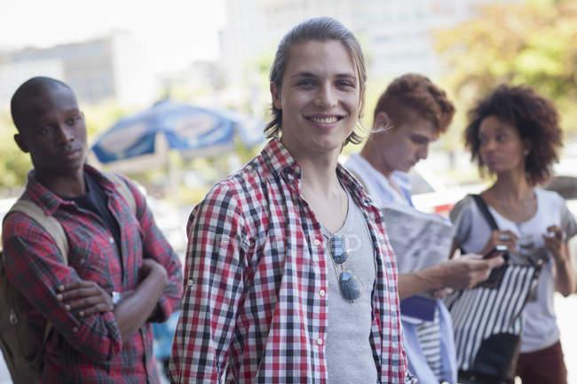 Young man smiling towards camera — Stock Photo
