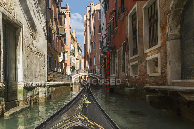 Part gondola with canal bridge in distance — Stock Photo