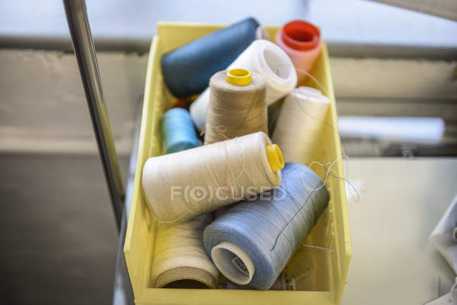 Coloured threads in fashion studio — Stock Photo