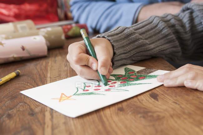 Boys hand drawing christmas tree — Stock Photo