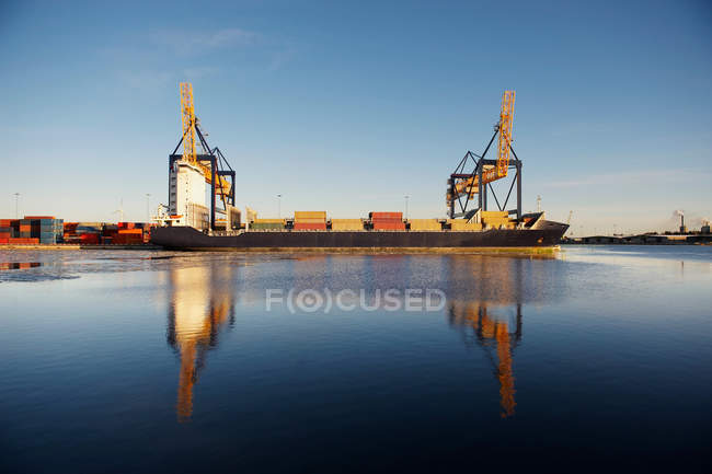 Containers on ship in container port — Stock Photo