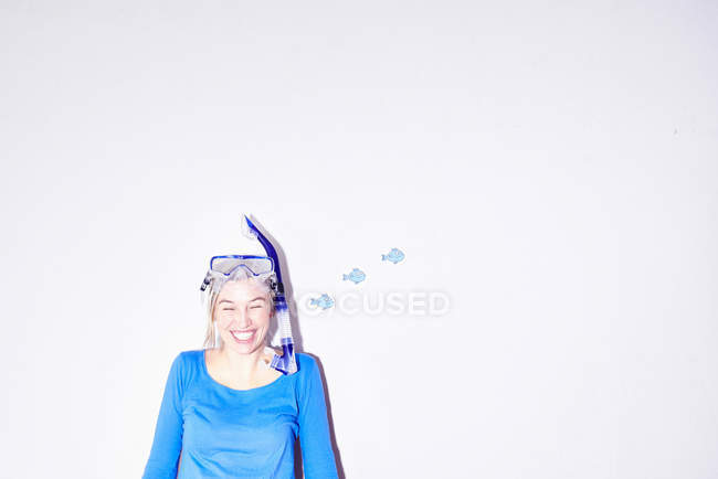 Portrait of young woman wearing goggles and snorkel mask — Stock Photo