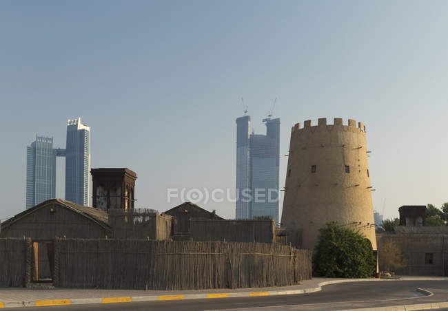 Old Arab fortress and modern skyscrapers — Stock Photo